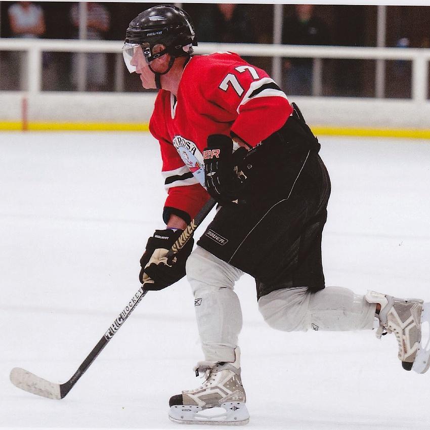 Big Lew playing hockey